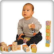 First Nations boy playing with blocks