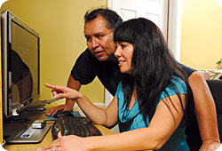 First Nations parents looking at computer screen