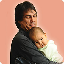 First Nations father holding baby